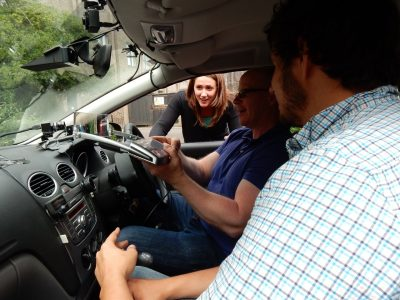 students sitting in a car