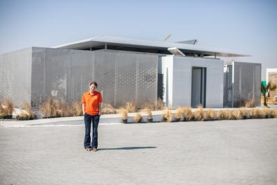 Student stands in front of FutureHaus
