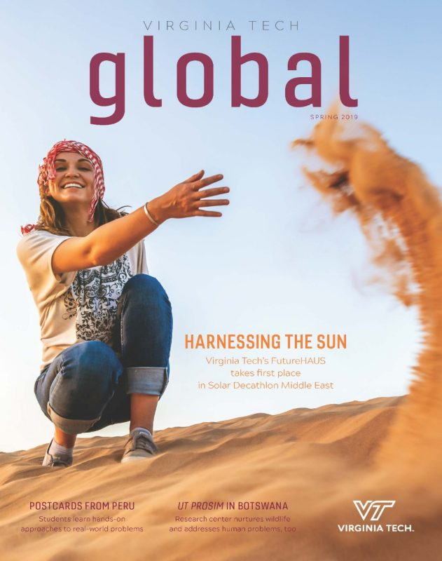 Spring 2019 cover image of a student in the desert throwing sand